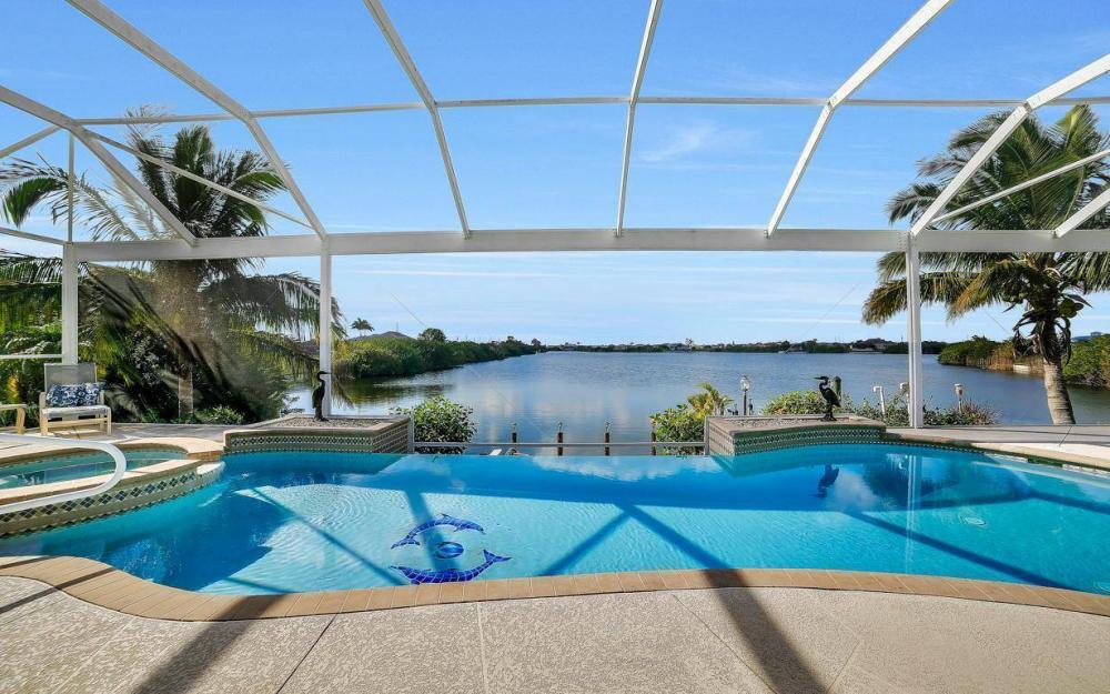 2422 NW 3rd Pl, Cape Coral - Home For Sale 1030785149