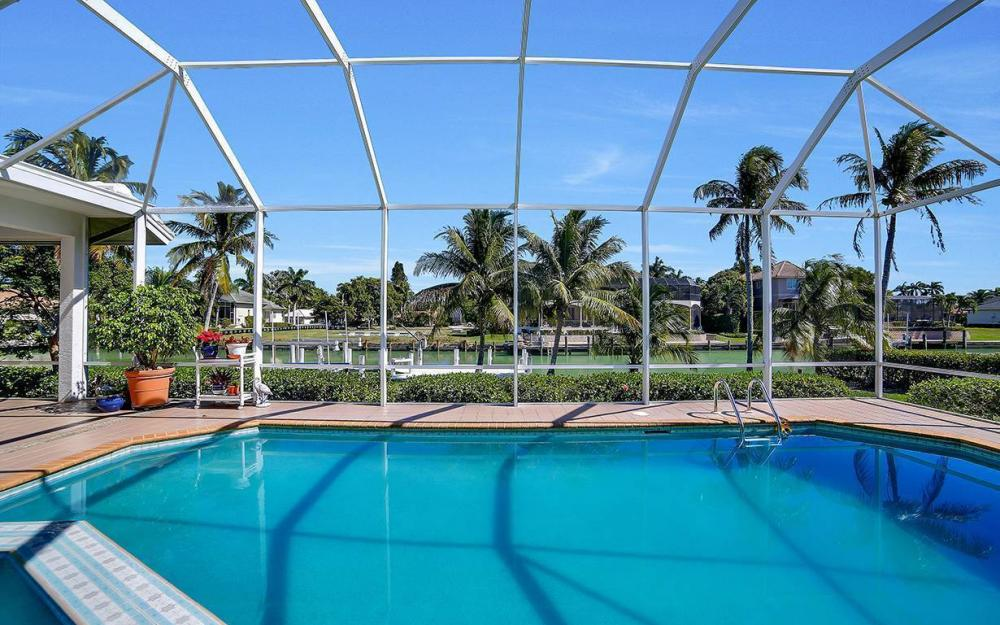 1021 E Inlet Dr, Marco Island - Home For Sale 261340426