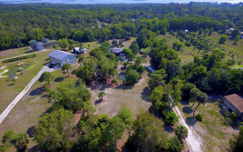 14001 Stringfellow Rd, Bokeelia - Home For Sale 2013790900