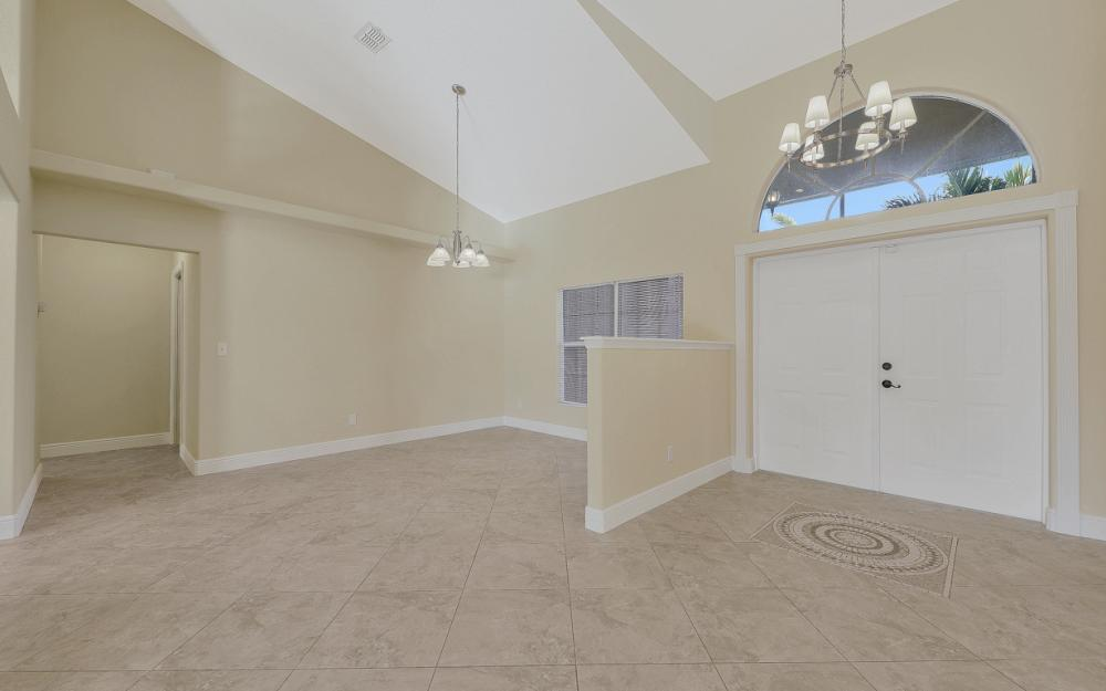 702 NW 38th Pl, Cape Coral - Home For Sale 162811579