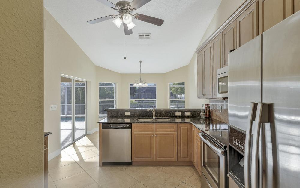 702 NW 38th Pl, Cape Coral - Home For Sale 2073018984