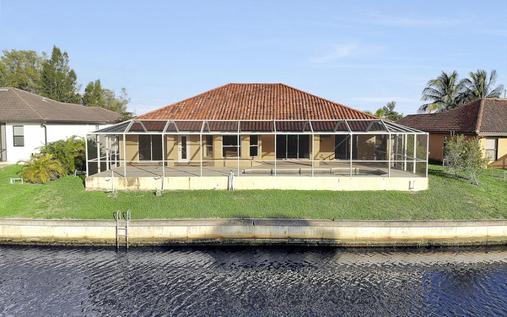 702 NW 38th Pl, Cape Coral - Home For Sale 444924613