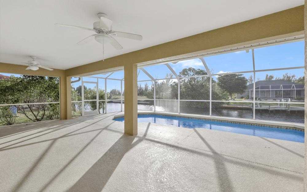 702 NW 38th Pl, Cape Coral - Home For Sale 1844021779