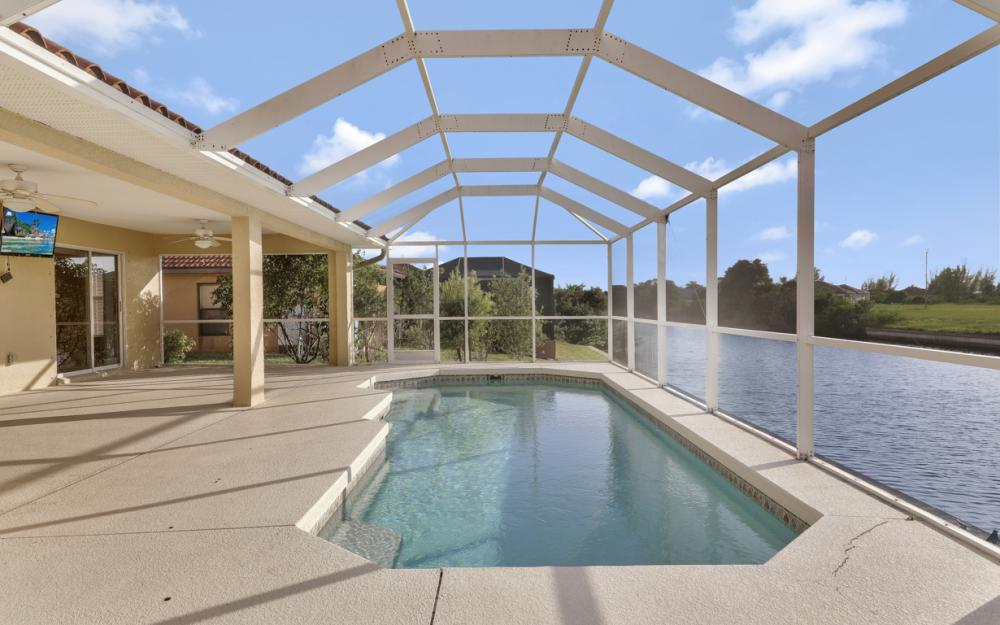 702 NW 38th Pl, Cape Coral - Home For Sale 2032660504