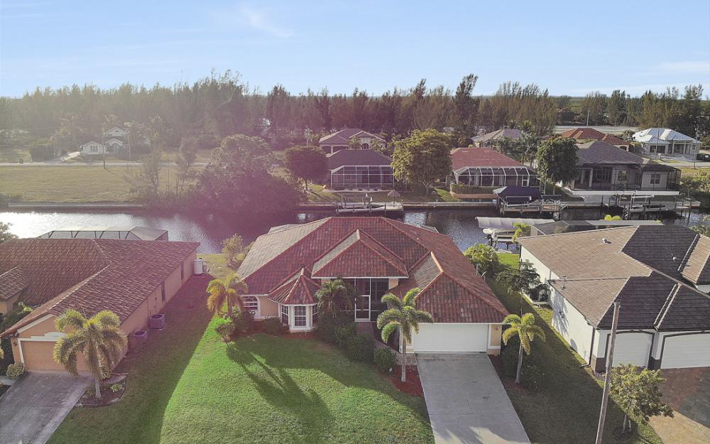 702 NW 38th Pl, Cape Coral - Home For Sale 221041177