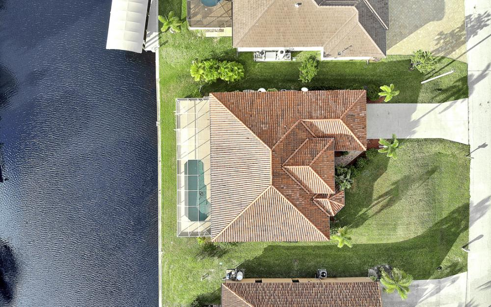 702 NW 38th Pl, Cape Coral - Home For Sale 1010902021