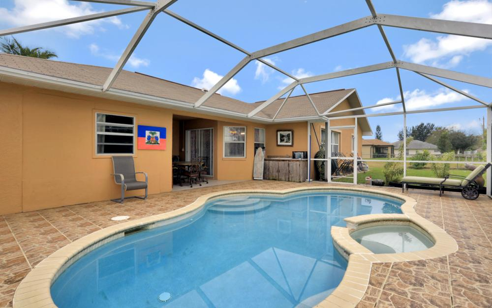 318 NE 17th Pl, Cape Coral - Home For Sale 2054255011