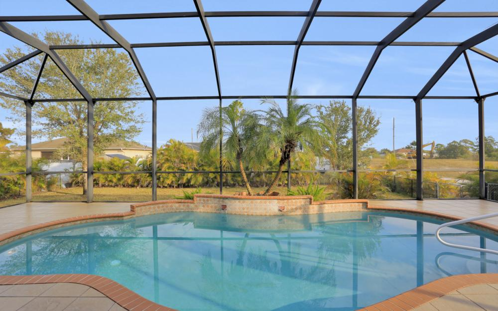 921 Diplomat Pkwy W, Cape Coral - Home For Sale 2058743345